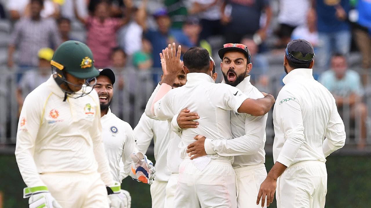 Indian captain Virat Kohli reacts after the dismissal of Australian batsman Travis Head.